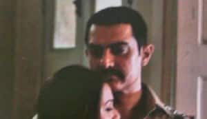Is Aamir Khan wearing a cop uniform in 'Dhuan' or not?
