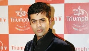 Is Karan Johar trying to hide his double chin?
