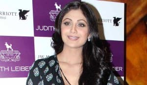 Why did Shilpa Shetty take three holy dips at the Kumbh Mela?